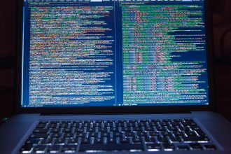 image of laptop displaying computer code